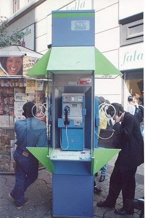 "Technician working in CTC payphone.</BR></BR><span class=""date-display-single"" property=""dc:date"" datatype=""xsd:dateTime"" content=""1997-04-01T00:00:00+00:00"">Apr 01, 1997</span>"